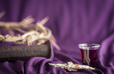 Commuion and Symbols of the Crusifixion on a Purple Cloth