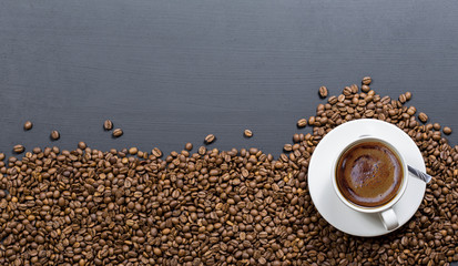 coffee cups on coffee beans, black textured wooden table