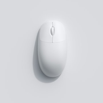 A White computer mouse on white background. top view, flat lay minimal concept.