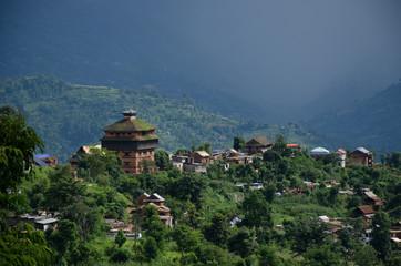Nuwakot ancient castle tower appears in the morning haze from a hilltop near Nuwakot village, Nepal.
