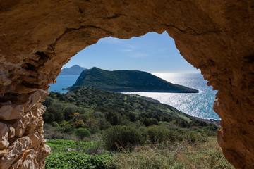 Sphacteria Island framed in arch, in Old Navarino Castle, Pylos, Peloponnese, Greece.