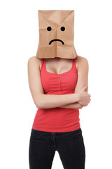 young woman wearing paper bag with sad smiley face over her head