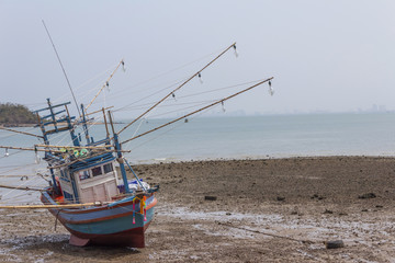 Old fishing boat parked on the beach.