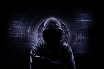 Internet crime concept. Hacker working on a code on dark digital background with digital interface around.