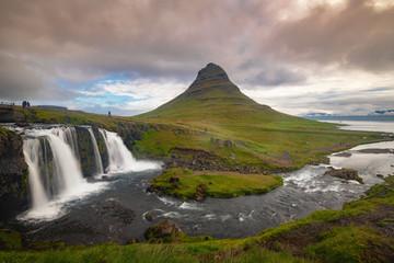 Wall Murals Waterfalls Kirkjufellfoss and Kirkjufell mountain in cloudy day ,Iceland.