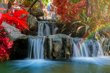 Waterfall in garden at the public park Wall mural