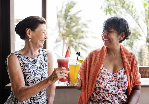 Senior women enjoying drinks in the summertime