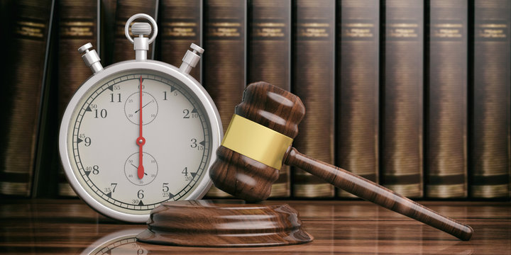 Stopwatch, timer and  judge gavel on law books background. 3d illustration