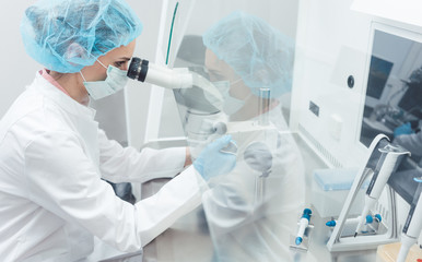 Doctor or scientist working on biotech experiment in laboratory