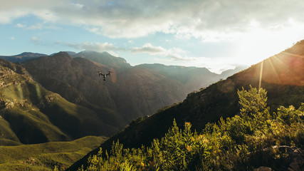 Quad copter drone flying over Jonkershoek nature reserve