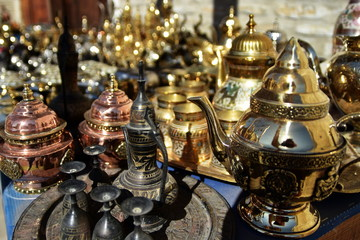 Ancient East dishes. Teapots, cups, lamps, jugs, made of gold, brass, handmade silver. A shopkeeper's shop. Uzbek Oriental Traditions. Bukhara
