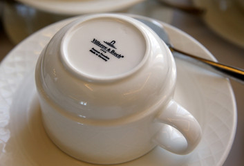 A Villeroy & Boch logo is printed on a coffee cup on a breakfast buffet at the Palace hotel in Lausanne