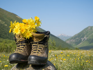 hiking boots and mountains landscape