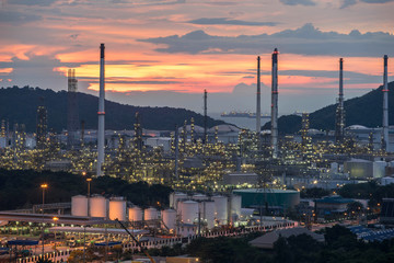 Beautiful sunset  petrochemical oil refinery factory plant cityscape of Chonburi province at night  , landscape Thailand