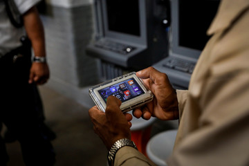 Inmate Marvin Worthy uses his JPay tablet device inside the East Jersey State Prison in Rahway, New Jersey