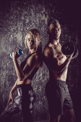 athletes with dumbbells