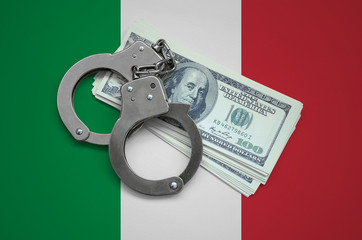 Italy flag  with handcuffs and a bundle of dollars. Currency corruption in the country. Financial crimes
