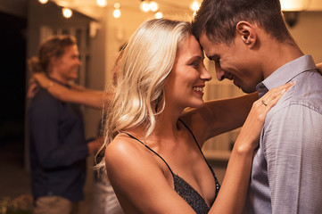 Romantic young couple dancing at party