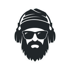 Bearded man in a knitted hat, sunglasses and headphones. DJ Hipster