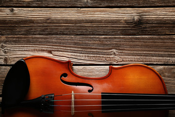 Violin on brown wooden table