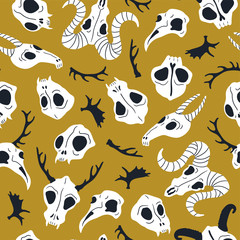 Vector seamless pattern with animal skulls. Halloween or Day of the dead design for fabric with cute skulls and horns.