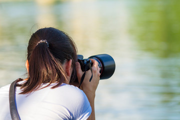 woman photographer photographing nature travel and leisure concept