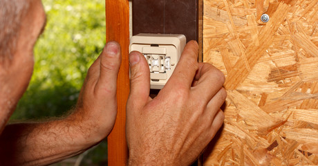 male electrician sets electrical switch for lighting