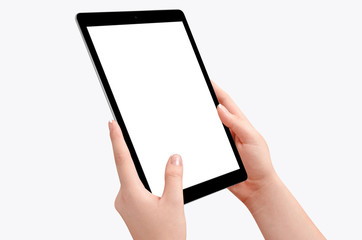 Female hands holding black tablet in vertical position isolated on white background. Empty screen for mockup design