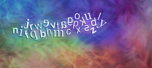 Chaotic Dyslexic Alphabet with reversed letters - wide rainbow coloured banner with a jumbled complete alphabet showing six moving characters reversed depicting dyslexia with plenty of copy space
