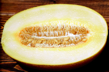 Melon cut in half with uncooked seeds
