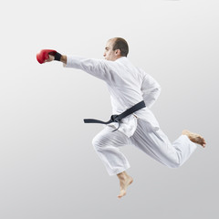 Blow hand in jump in perfoming an adult athlete