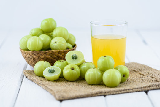 Indian gooseberry on wooden table