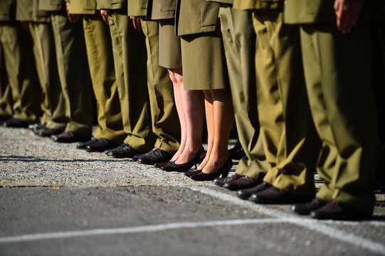 Soldiers in uniforms standing in formation during military ceremony