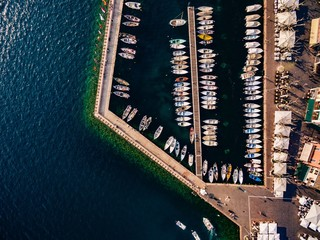 Aerial view of marina lot. Boats in the port in Italy.