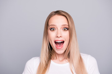 People emotions concept. Close up portrait of good news cheerful cute joyful surprised with long hair isolated on gray background