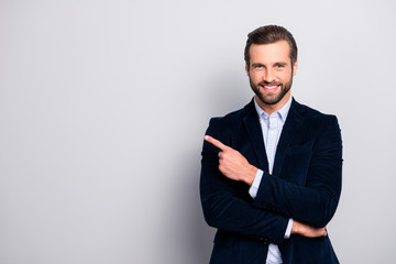 Portrait of cheerful excited joyful satisfied handsome attractive fashionable macho guy dressed in formal outfit dark velvet pointing on empty blank copyspace isolated on gray background copy-space Wall mural