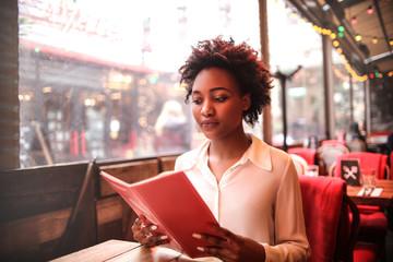 Woman reading a menu in a restaurant