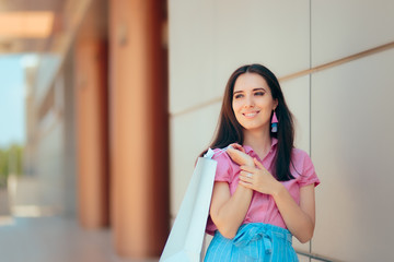 Fashion Girl with Shopping Bags in Front of the Mall