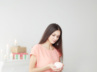 portrait of a thoughtful young woman with a candle