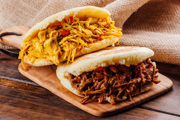 Typical South American breakfast, arepa with chicken and roasted meat