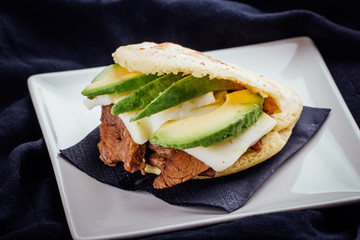 Arepa made with avocado, meat and cheese