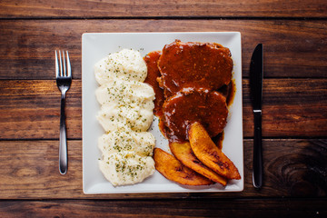 Asado negro with mashed potatoes and fried plantain