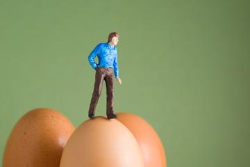 Walking on Eggshells - model figure on top of eggs