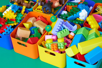 Toys and cubes for children in colorful boxes.