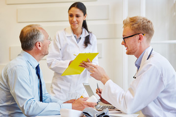 Senior patient receives advice from doctors