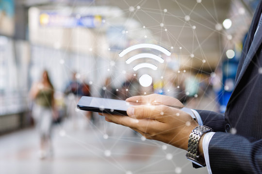 Businessman connect the tablet to wifi .