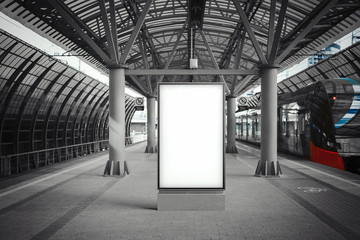 Blank white banner at metro station with arrived train on a background Wall mural
