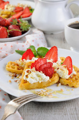 Belgian waffles with whipped cream and strawberries