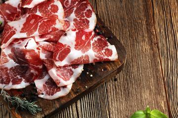 Italian sliced cured coppa with spices. Raw ham. Crudo or jamon