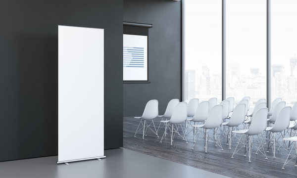 Blank white roll up next to meeting room in modern office, 3d rendering